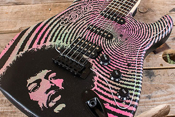 Jimi Hendrix design pink and neon green psychodelic swirl Burntaxe tribute guitar available to buy at The HAre and Hounds Pub in Brighton England