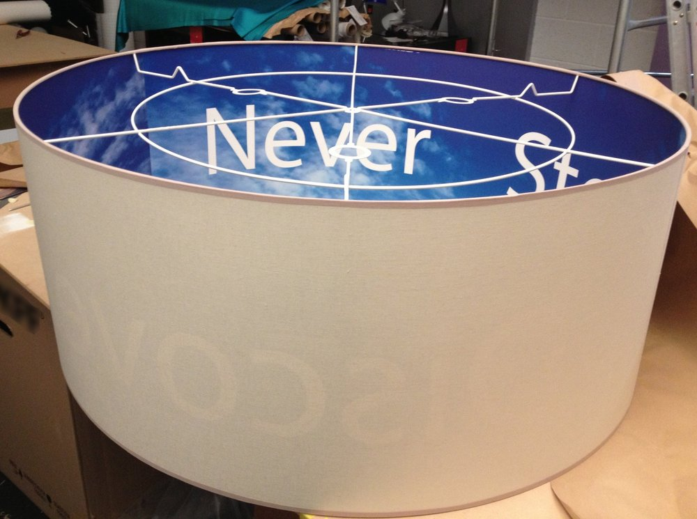 Blue sky thinking in visual merchandising; this large format lampshade was part of a series featuring inspirational phrases and imagery.  Produced using digital print technology.