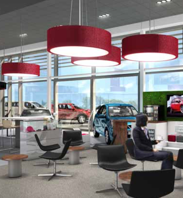 Huge lampshades to create an on brand feature and provide general lighting to this car showroom.