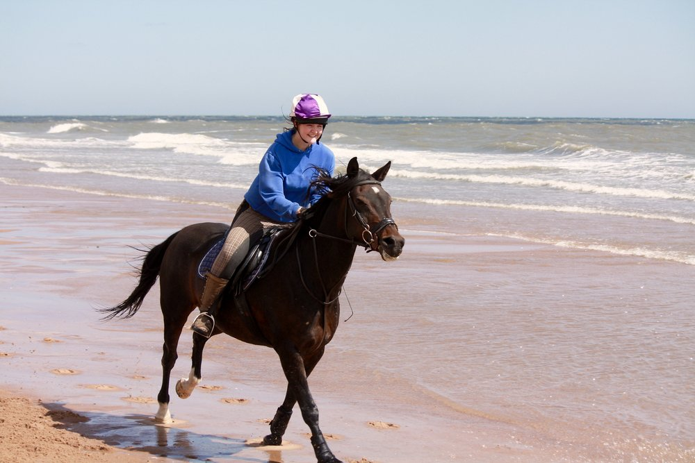 Chiara with horse Danny at  the Balmedie Beach in Aberdeen.