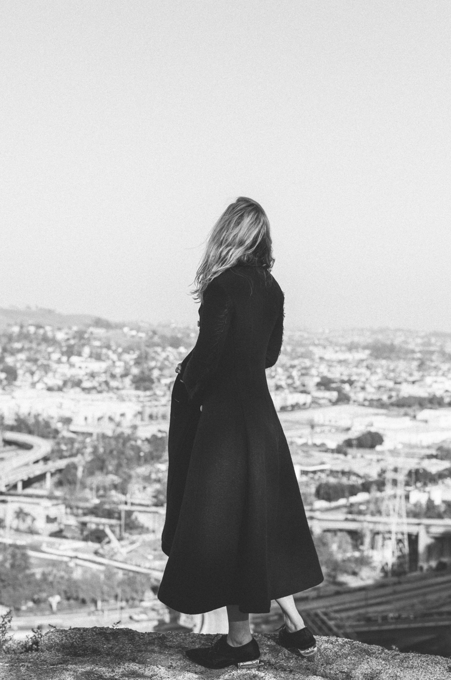 Coat: Céline; Dress: Prada; Shoes: Rochas