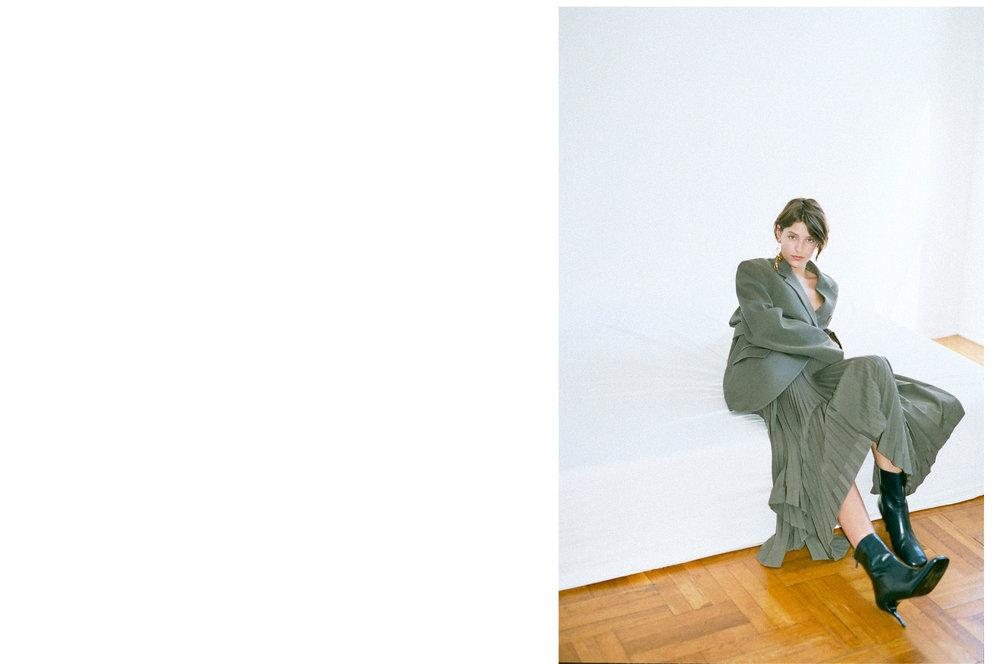 Blazer & skirt: Celine; Boots: Dorateymur; Earring: Mounser