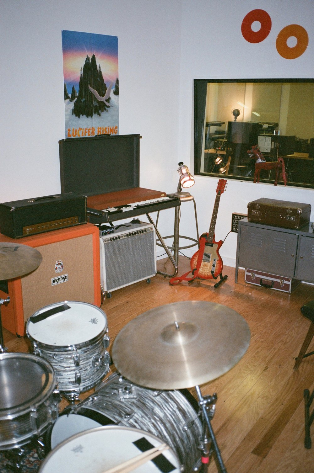 Out 60s Pearl Oyster Ludwig drum kit, Orange cabinet, Marshall and Fender amps...