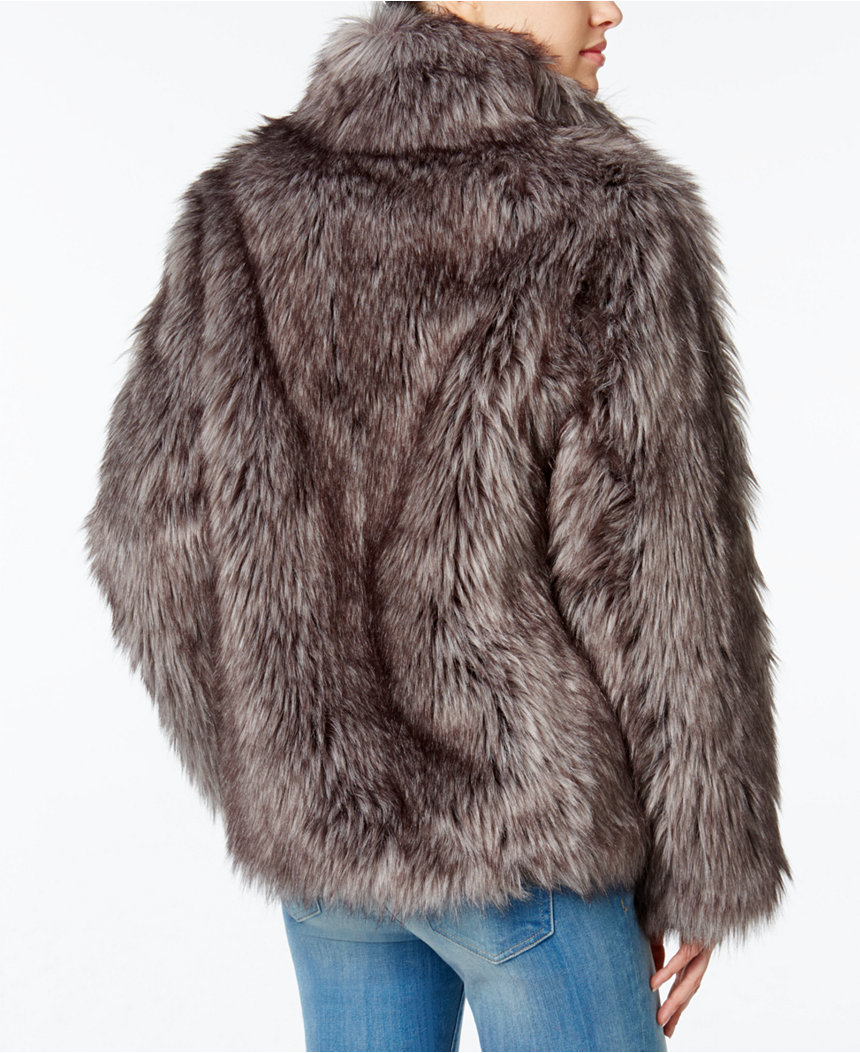 I bought this faux fur coat in a medium to sit slightly larger on my frame and be synonymous with the early 90's rapper aesthetic.