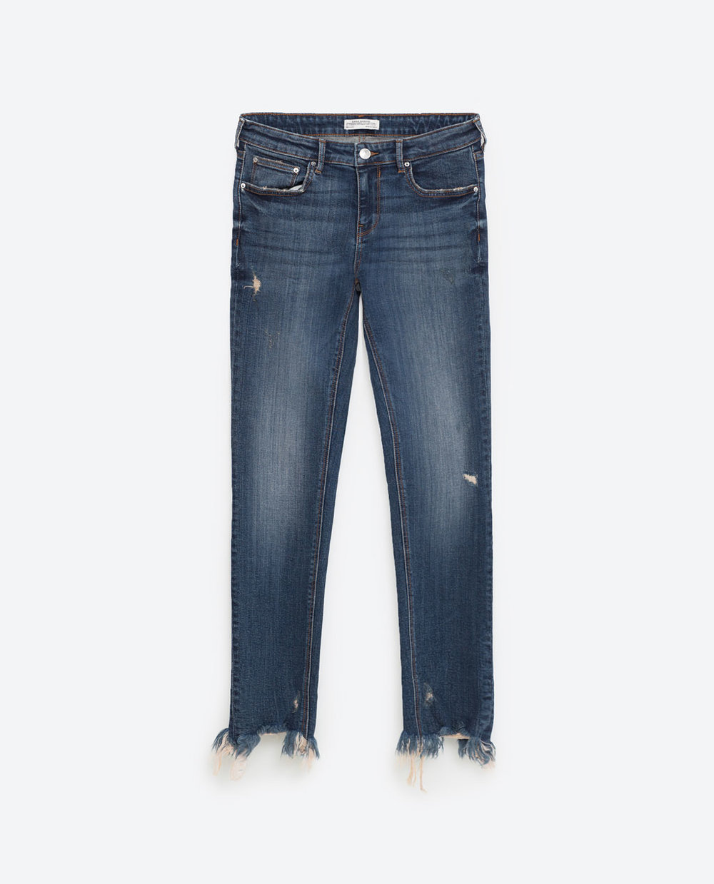The jeans in the video were thrifted and DIY-ed, but if you wanted to save the trouble, I hear Zara's hopping on the distressed denim hems.