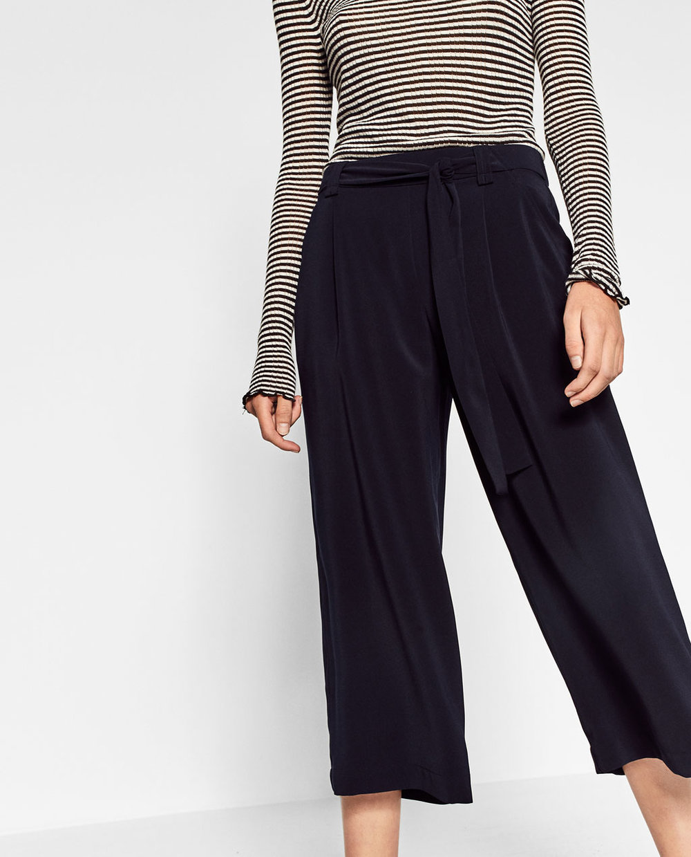 Excited that culottes are finally a thing in the US. Unlike straight legged capris that might cut off the length of your legs if you are a little shorter than the average human, culottes have a wider pant leg that closely resembles the flow and movement of a middy skirt. When made high-waisted, the silhouette is universally flattering.