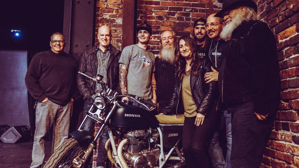 Some of our favorite faces gathered around Tiffany Hargis and her new custom built bike.