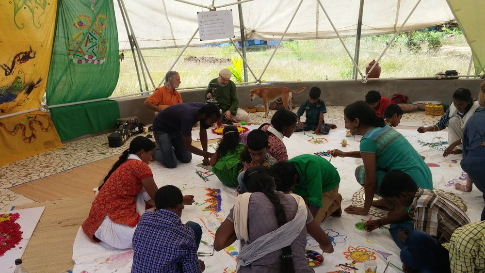 Our new found friend and colleague Tugay from Turkey playing music for children from the local villages around Auroville in an expressive arts workshop with Kripa Devi in her beautiful geodesic dome Sankalpa (which means intention or affirmation).