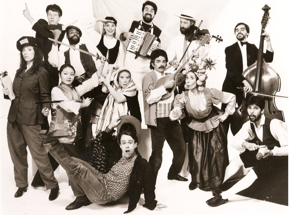 """Streets of Gold."". with The Company, circa 1988. Photo by Gideon Lewin.  Company Members, clockwise spiral from top left: David Tichner, Michael Scott, Margaret Morrison, Michael Samsonia, Evan Stover, Marco Brehm, Ira Bernstein, Ted McKnight, Marjorie Berman, JeanneChin, Rachel List, Bill Vanaver and Livia Vanaver Drapkin Vanaver."