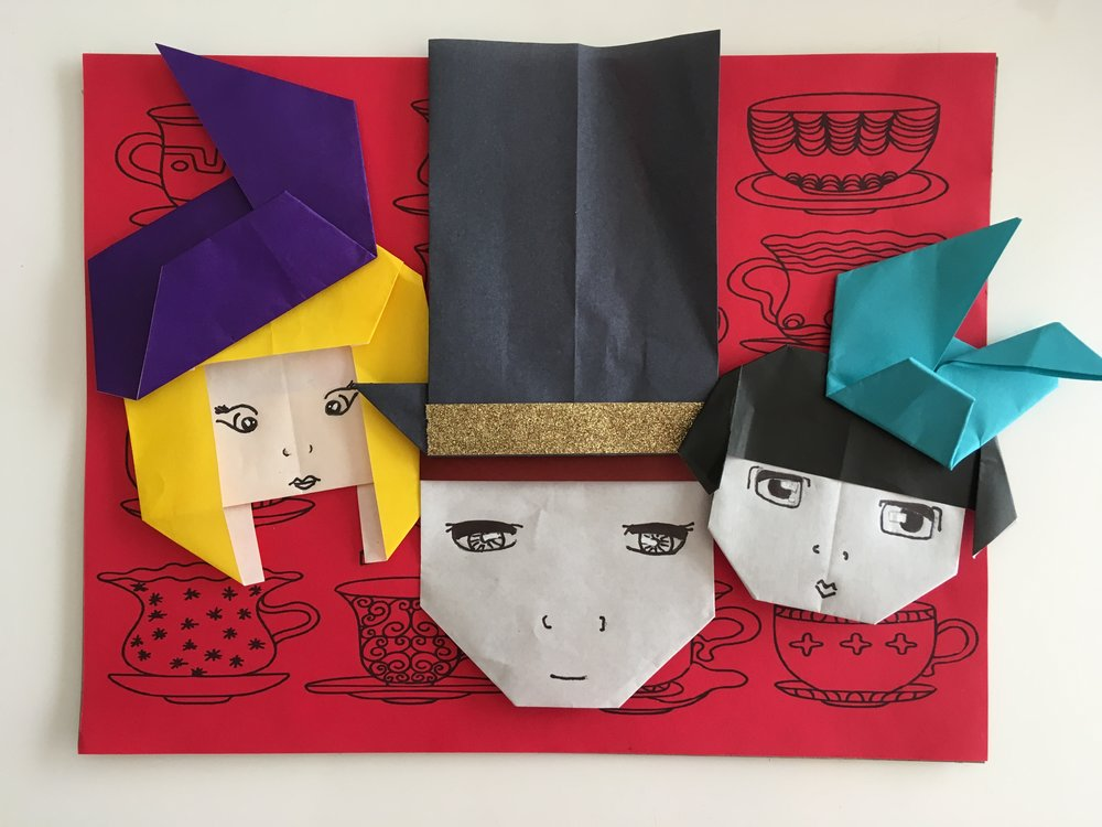 "This is one of my school projects where I designed the Origami faces and hats for a ""Mad Hatter"" theme."
