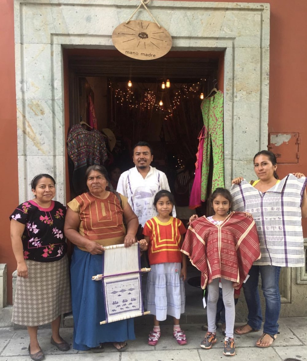 the family of the local artisans from istmo de tehuantepec, in front of the mano madre pop-up shop at hostal de la noria, oaxaca