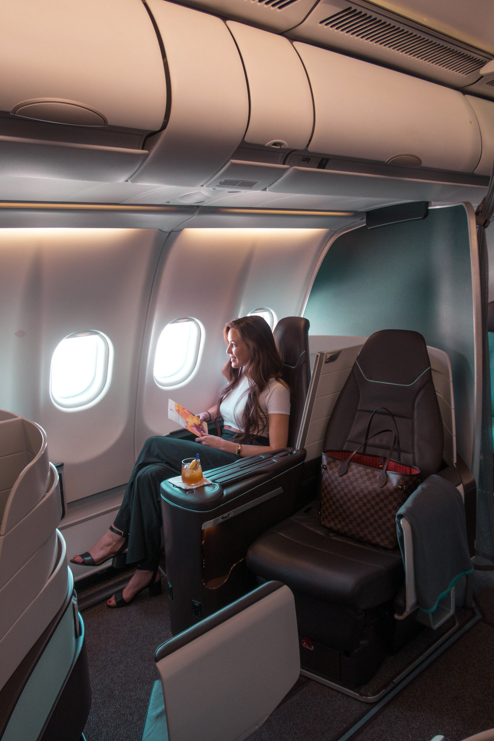 Hawaiian Airlines First Class Cabins feature lie-flat seats worthy of an international flight. Meal Service menus are designed by featured chefs renown on the islands.