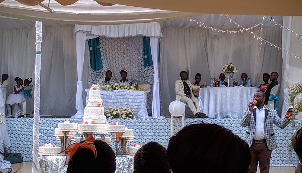 Enjoying a Ugandan wedding reception