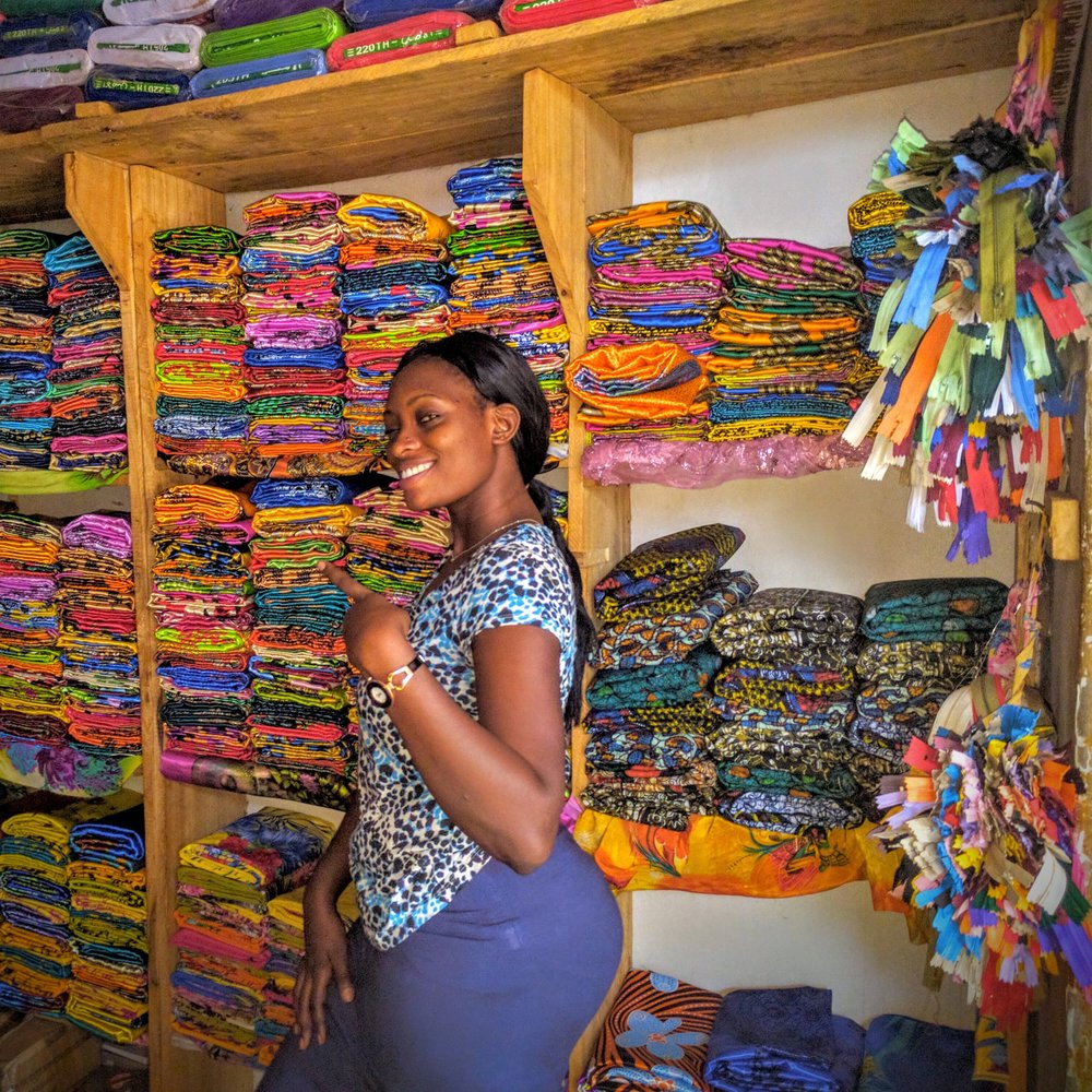 Purchasing fabric with Helen for my Gomesi dress – traditional Ugandan cultural dress