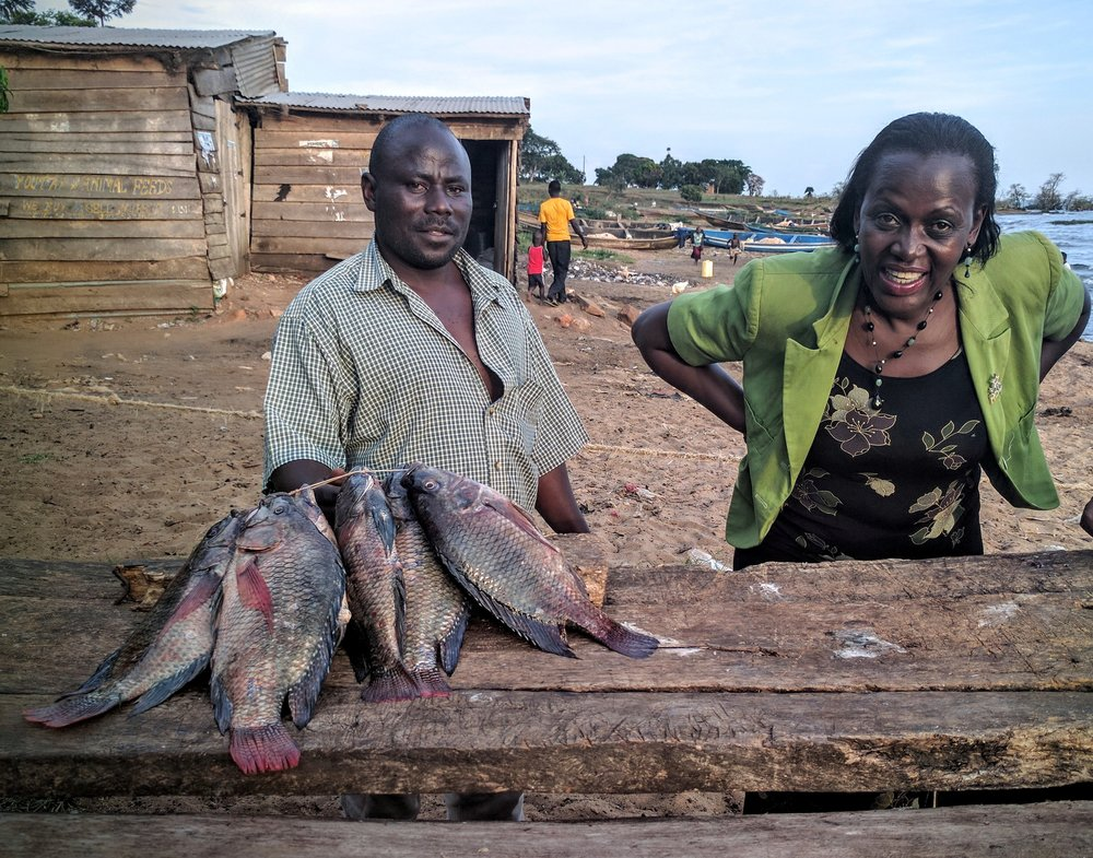 Picking up fresh tilapia at a small fishing village on the lake