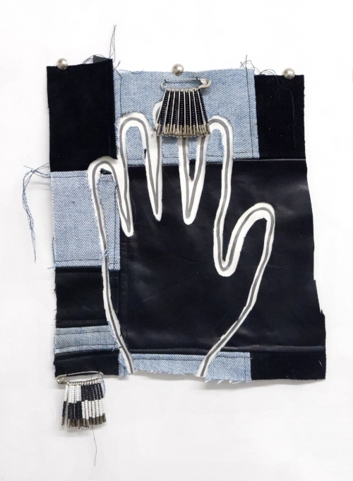 Cave Painting   Denim, leather, furniture nails, safety pins, paper, graphite, seed beads.  11 x 9.5 inches, 2018