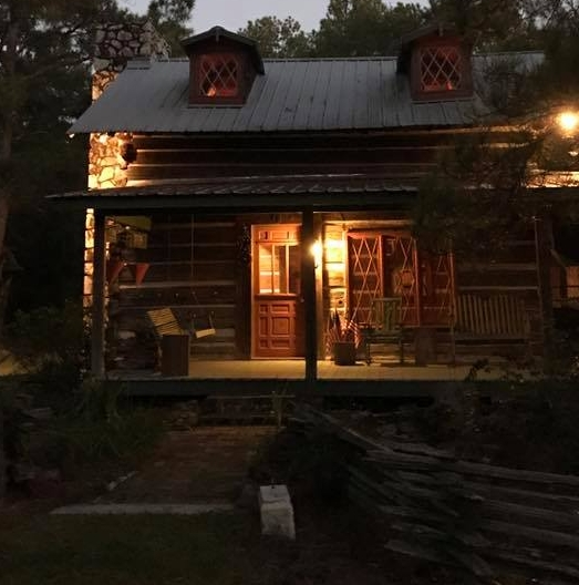 The circa 1819 cabin with private living room and loft bedroom and bath. Large stone fireplace in living room!
