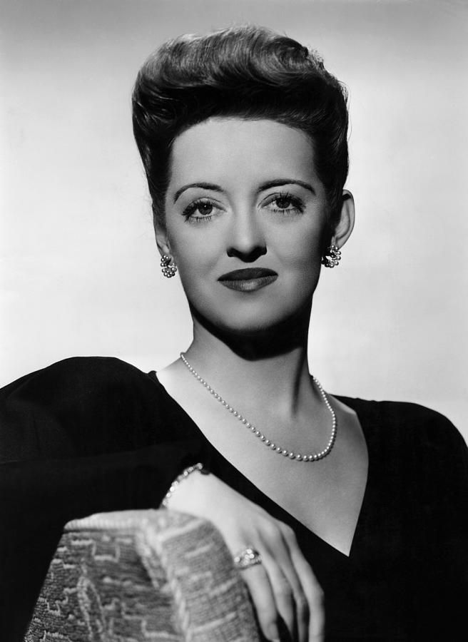 "Bette Davis wears a ""Princess"" length pearl necklace"