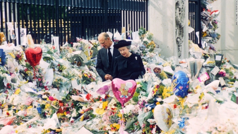 Queen Elizabeth and Prince Philip survey the tributes to Diana.