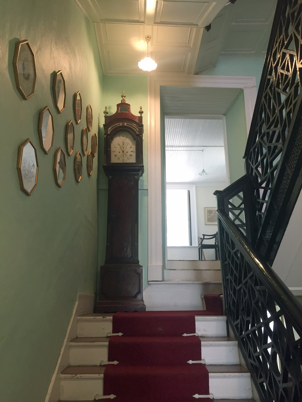 1746 Chippendale staircase has a different pattern on each floor.