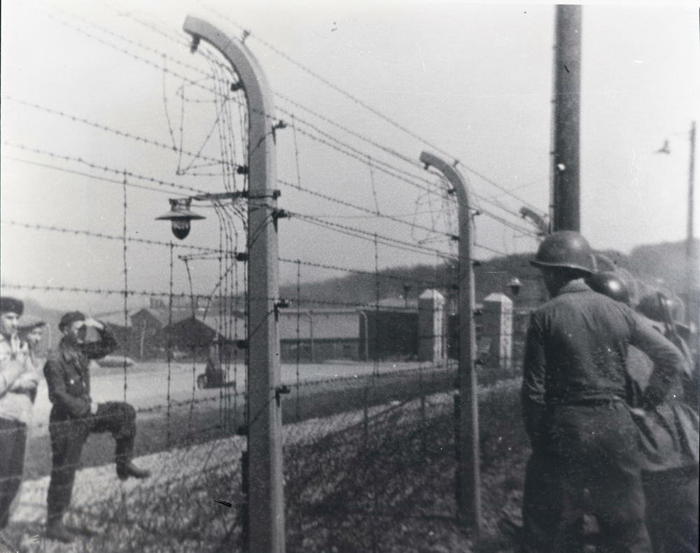 Shown here is one of the images from the Buchenwald Concentration Camp collection recently offered by an anonymous donor to the Digital Watauga Project. We believe that the image may show US soldiers speaking through the Buchenwald barbed wire with Russian prisoners who had escaped from Buchenwald and were the first to greet US soldiers from the Sixth Armored Division of the US Third Army. These Russian prisoners then led US troops back to Buchenwald to liberate the camp and were held for extensive interrogation about the camp by US forces. The image is shown here courtesy of the United States Holocaust Memorial Museum, which is now the rights holder of these images as of October 27, 2016.