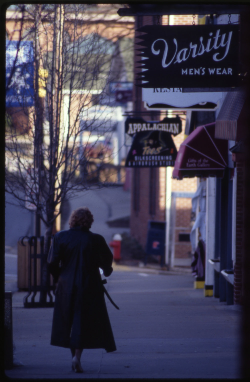 A woman walks east on West King Street toward the intersection with Appalachian Street during the 1990s. Image courtesy of the Downtown Boone Development Association Collection (Dow-Boo-1-013), Digital Watauga Project.