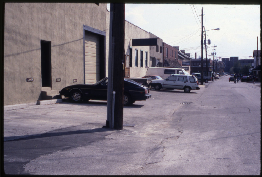 Visible at left in the 1990s is the building on the north side of Howard Street originally known as the Boone Tire and Bargain Store Warehouse (1944), followed to the east by the building originally known as the Baker-Commack Hosiery Mills Building (1944). The latter building is presently home to The Local restaurant and features a massive wooden porch structure on its south elevation. Image courtesy of the Downtown Boone Development Association Collection (Dow-Boo-1-070), Digital Watauga Project.