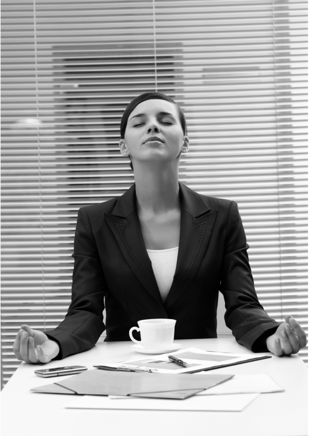 Corporate woman meditating B&W.png