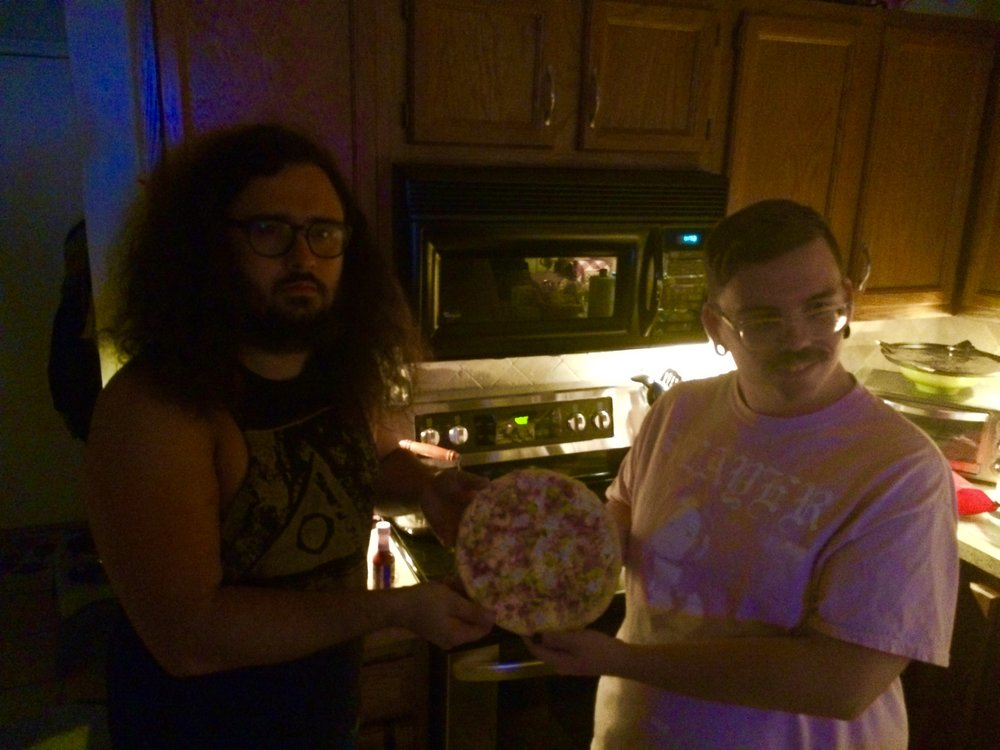 Daisy and his good friend Zach being pizza models. Zach let us crash at his house.