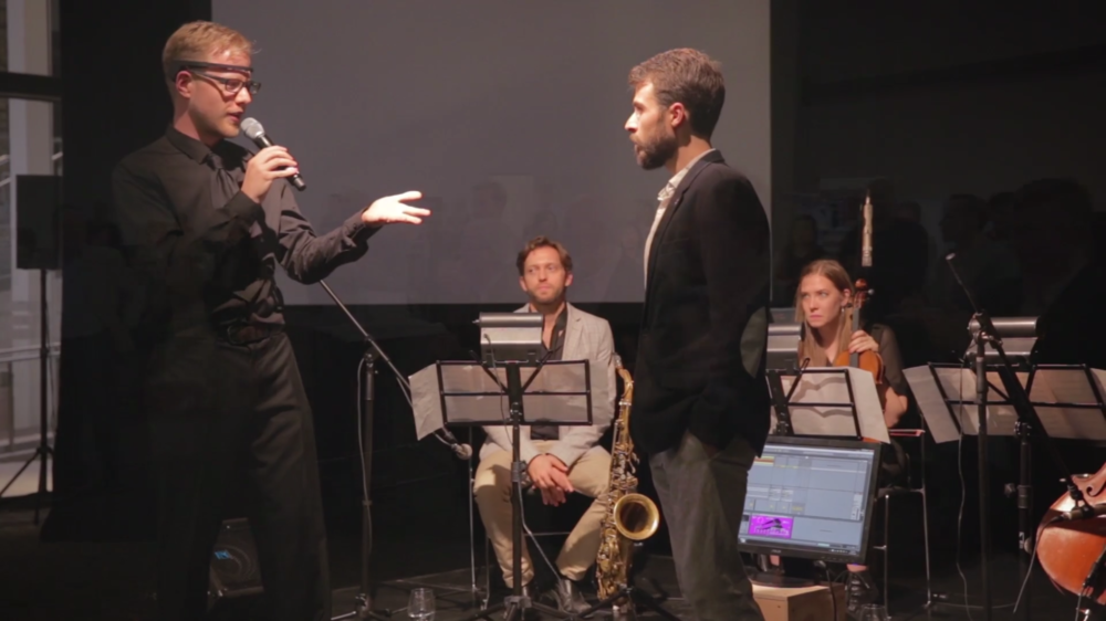"""Matt Roberts (collaborator) and Keaton on stage at Synaptive Medical's launch of """"Servo"""". Click through to see the video. Still: Peter Hatch"""