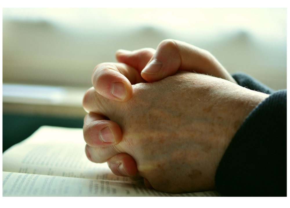 pray with Bible.png