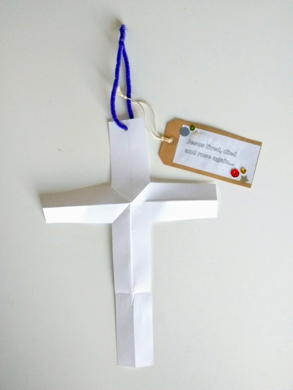 A paper cross_The road to Golgotha