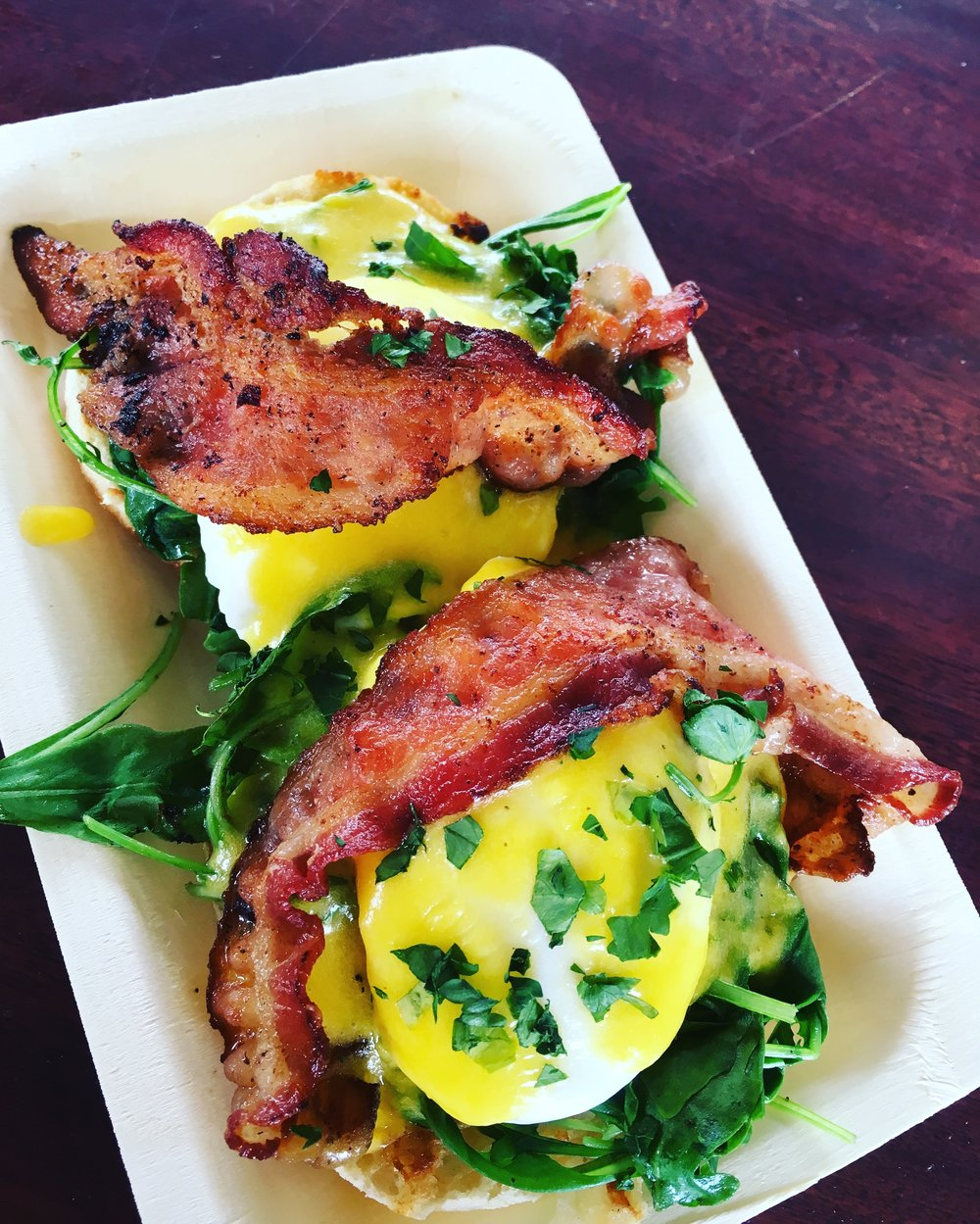 Eggs Benedict with Poached Eggs, Bacon, Arugula and Hollandaise on English Muffins