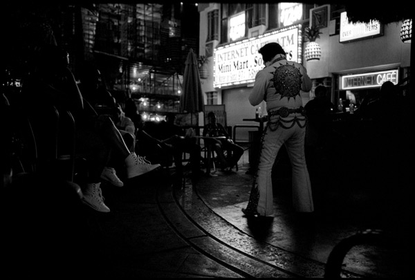 Black and White Photographs: Elvis Impersonator, 3:45 AM on the Vegas Strip
