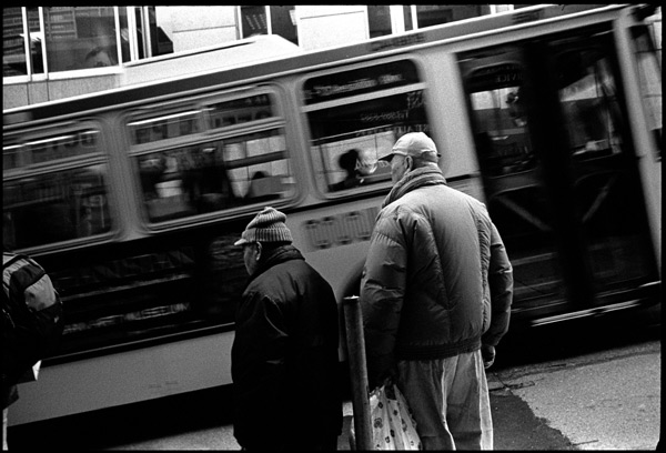 black and white photograph: #1 california bus stop, chinatown, san francisco