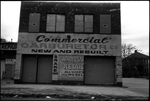 black and white photograph: commercial carburetor, detroit, michigan