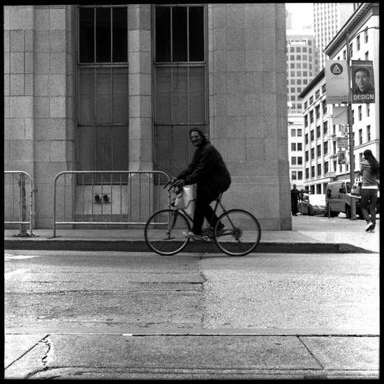Black and White Photograph: Man On A Bike, San Francisco