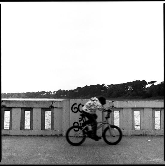 Black and White Photograph: Boy On Bike, Lake Merced, San Francisco, California, 2010