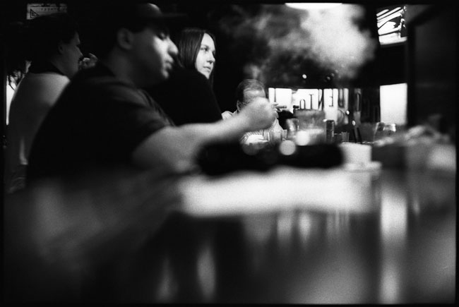 black and white photograph: the occidental cigar club, san francisco, ca. 2011