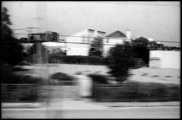 0226_34A black and white photograph train window, san mateo california