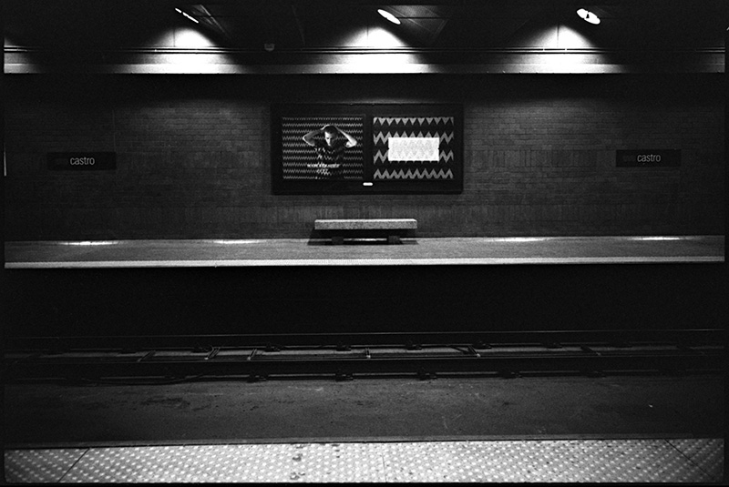 black and white photo castro street muni station san francisco