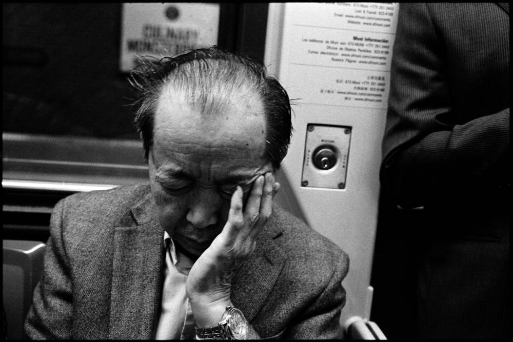 #0443_21A - Commuter, Muni Train. San Francisco, CA. March 2016. Leica M2, Zeiss 35mm f/2, Ilford HP5 400.