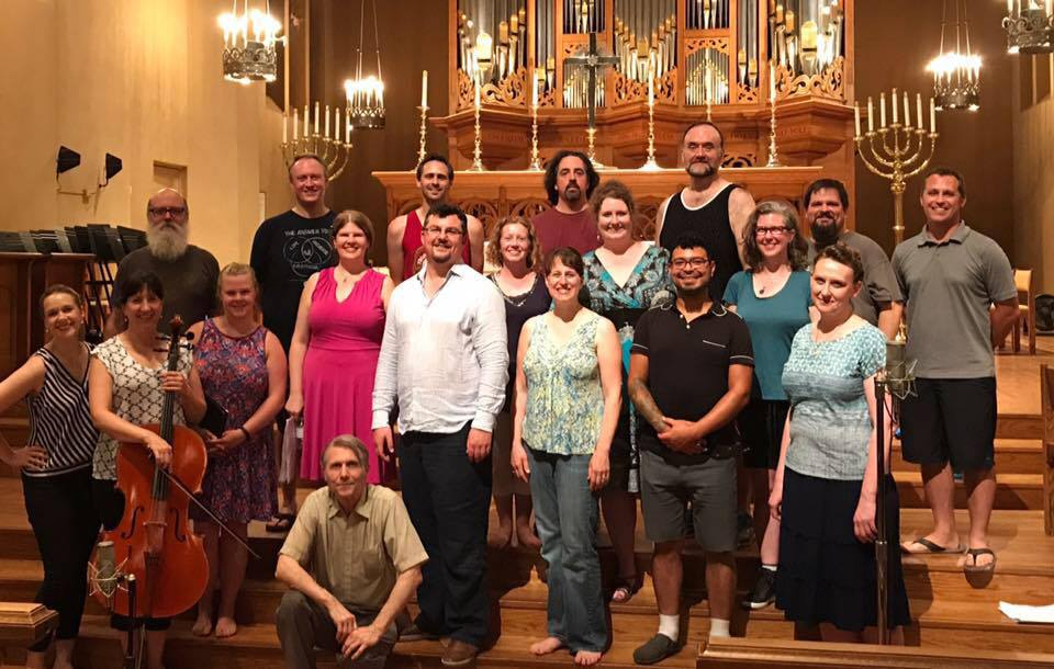 Resonance Ensemble and other Portland area musicians surround the composer, Desmond Earley and RE Artistic Director, Katherine FitzGibbon  at a recent rehearsal.