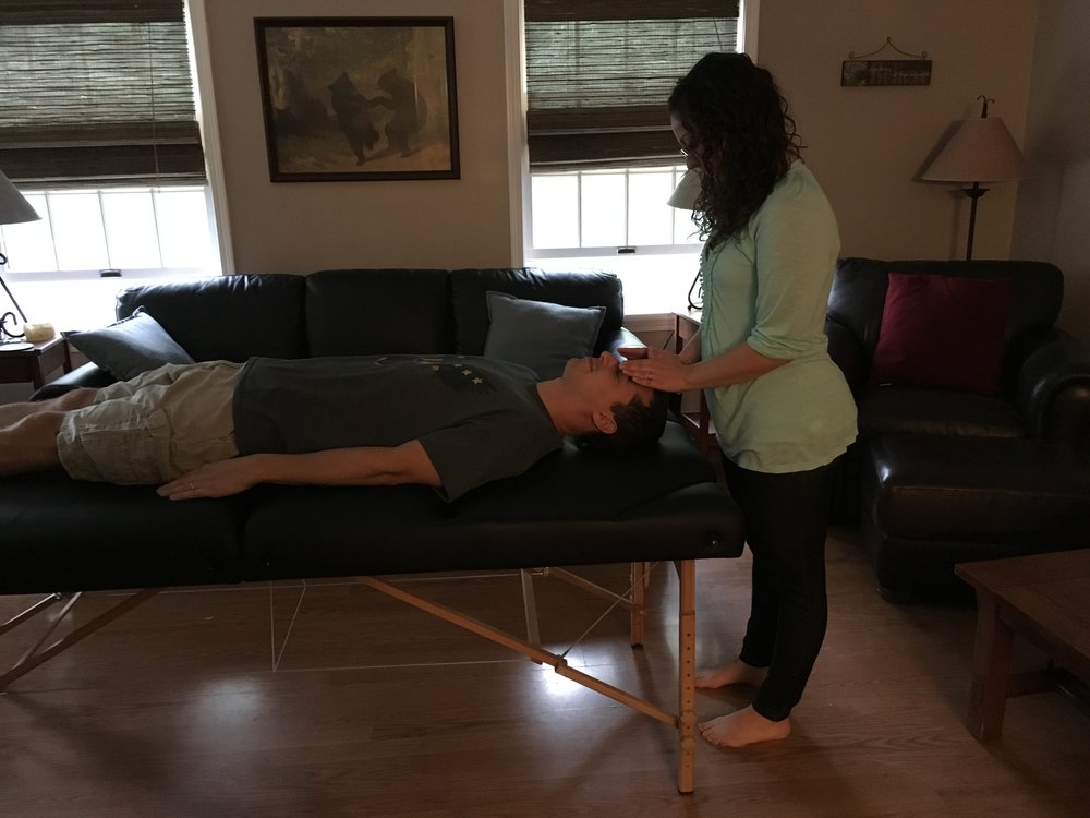 "One of my student's practicing Reiki techniques.  Simply stated, ""Reiki is a technique for deep relaxation.  When our bodies are fully relaxed they can heal themselves more quickly."" Jennifer Brodigan"