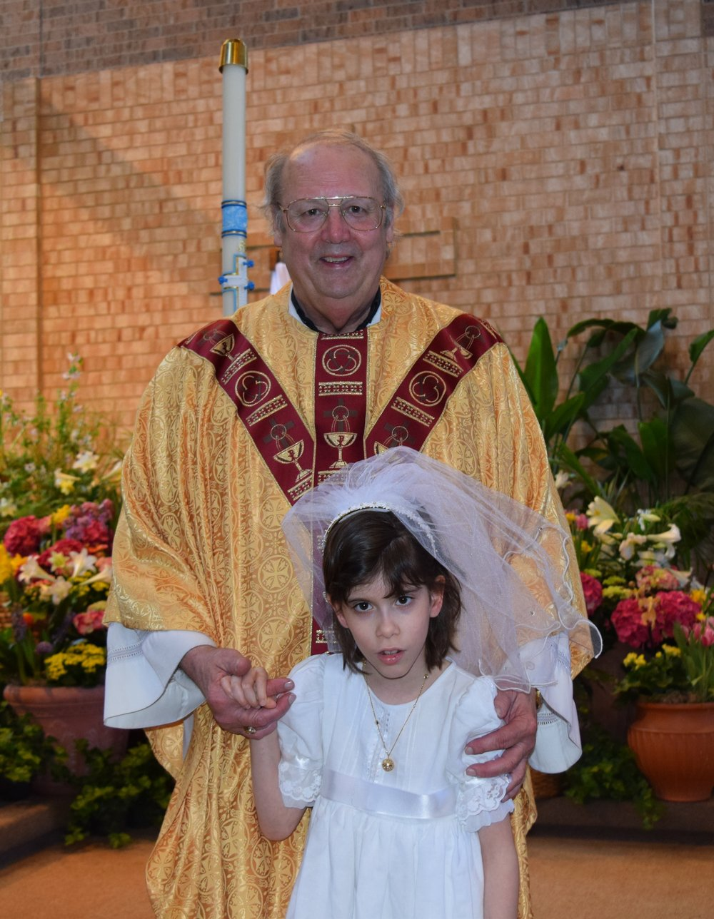 Fr Ryan and Natalia 1st communion 2.jpeg