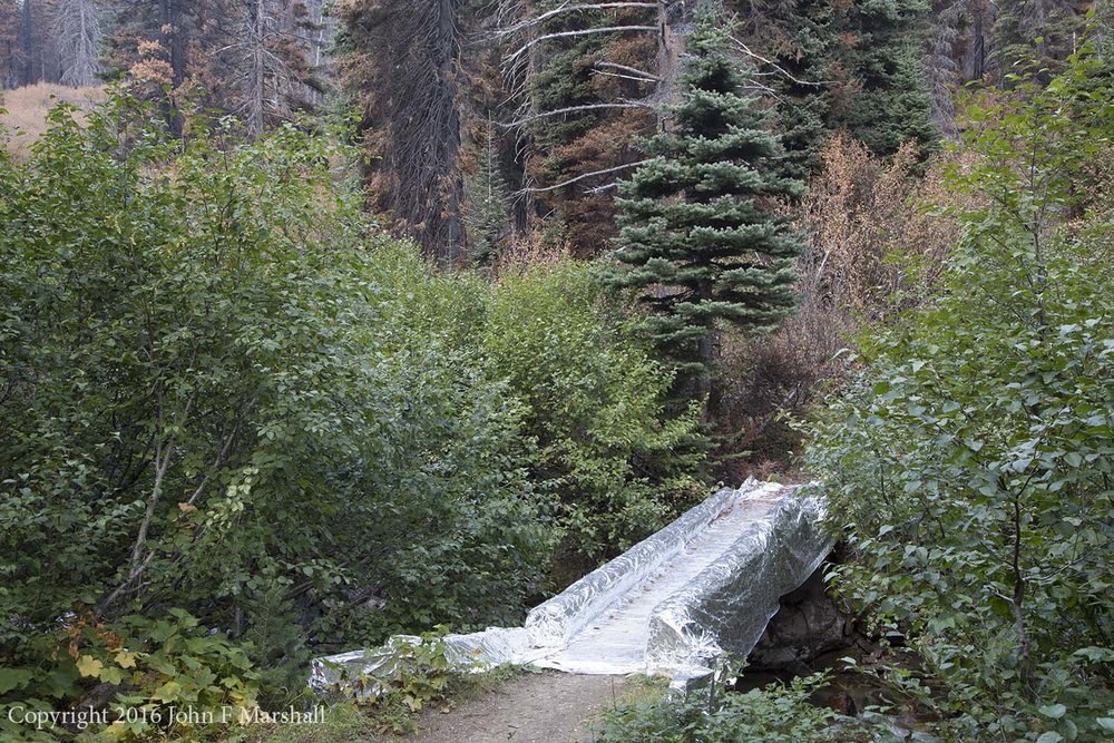 Bridge over the Chiwawa River wrapped for protection.  This material is much heavier than ordinary aluminum foil.
