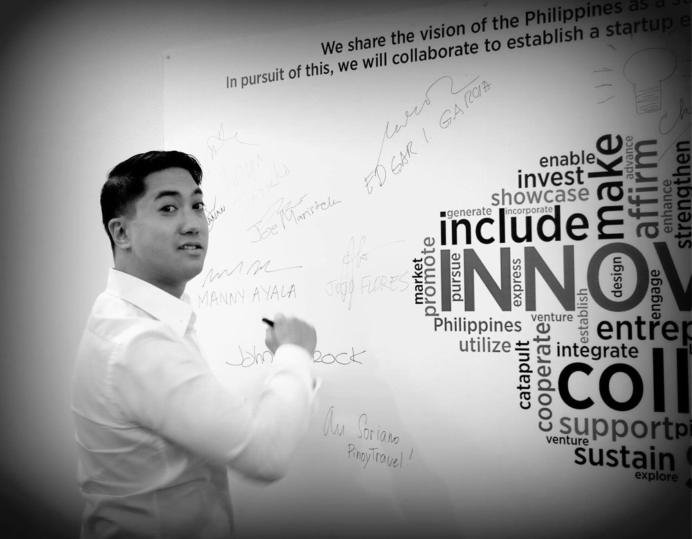 Joe scribbling on a whiteboard at a DTI office in Makati. Photo Credit: JoeMaristela.com