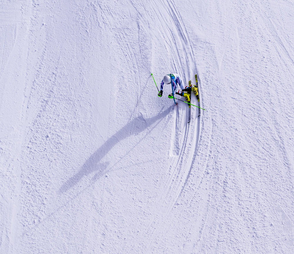 A female slalom skier carves into a turn at Copper Mountain in Colorado.