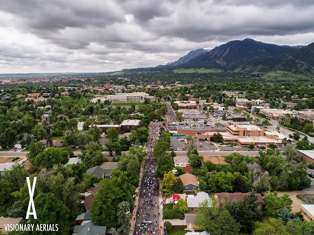 The Bolder Boulder as runners head towards the race finish at Folsom Field on Memorial Day.  #bolderboulder #memorialday #bouldercolorado #colorado #dji #aerialphotography #10k #running