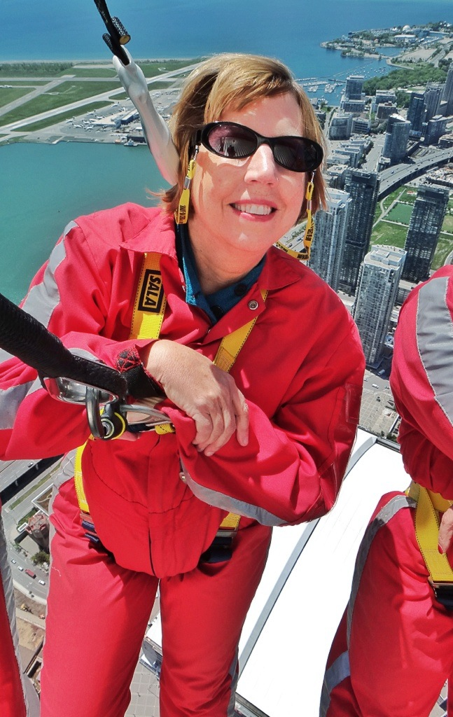 Cool as a cucumber: Laura Bly takes a breather 116 stories above Toronto.